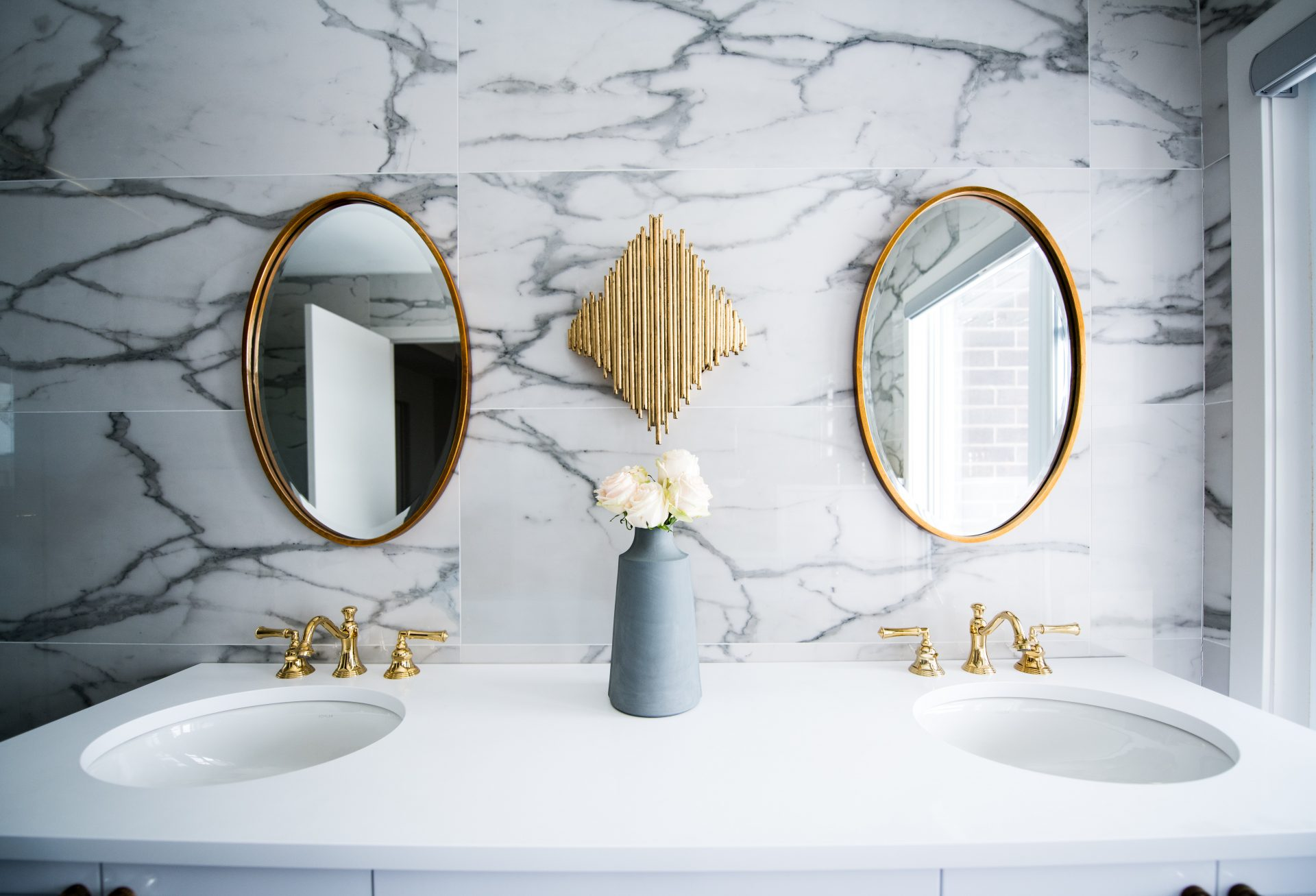 Photo of a double-vanity bathroom with marble textures