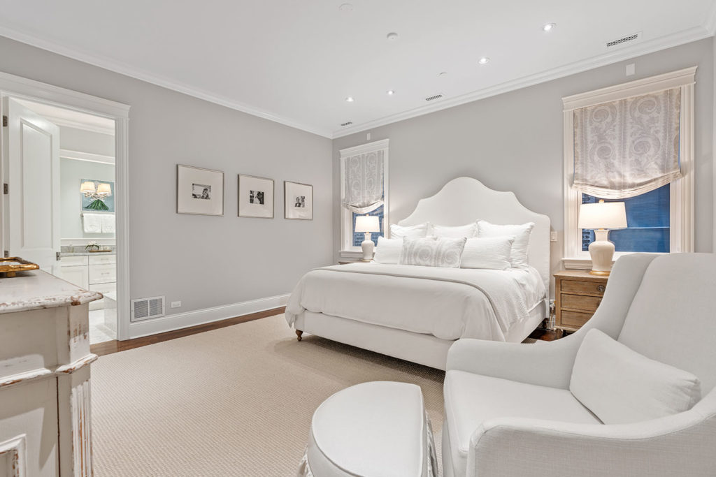 Photo of a primary bedroom with furniture and decor