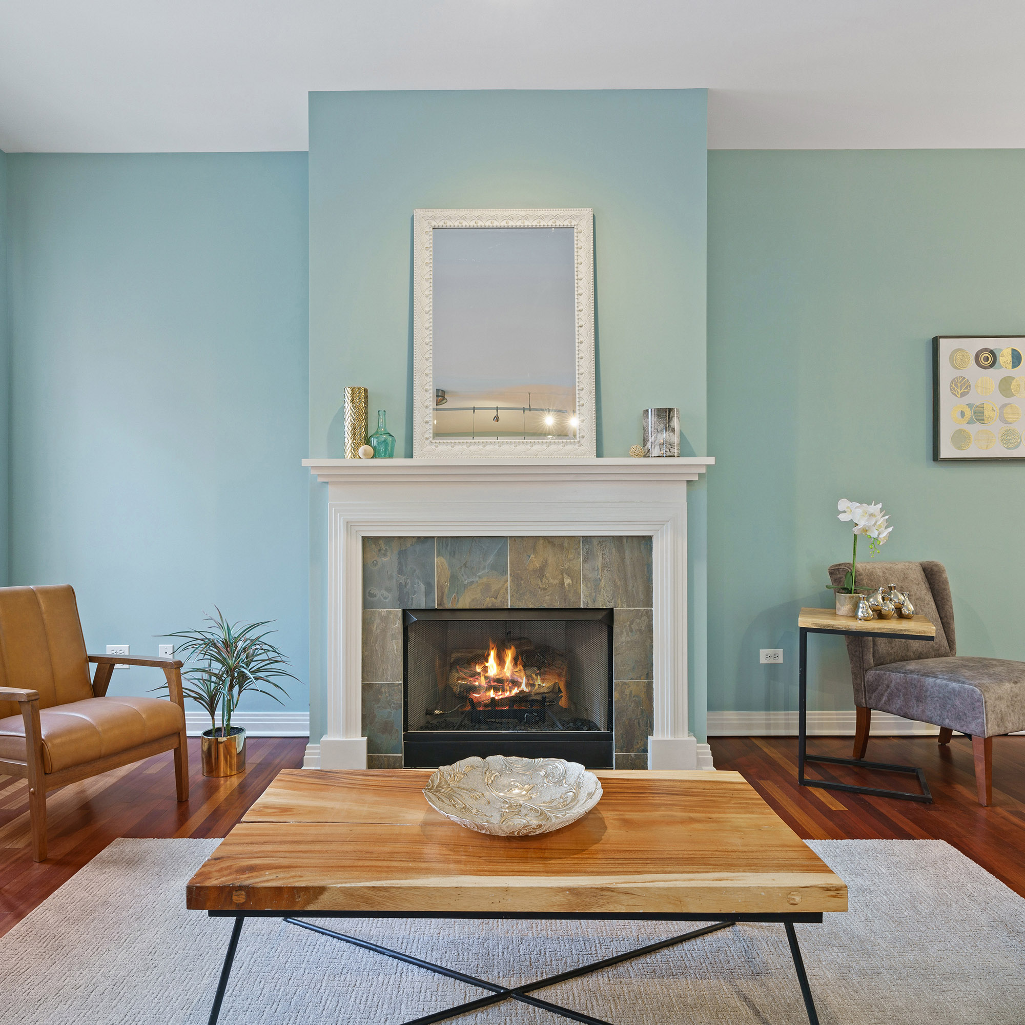 Bright blue wall in a living room, an example of color theory in your home