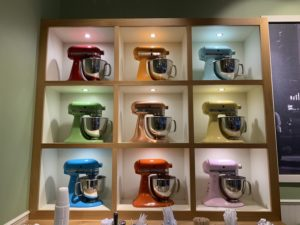 Nine brightly lit, colorful mixers sit in a nine cube built into the wall at Stan's Donuts & Coffee.